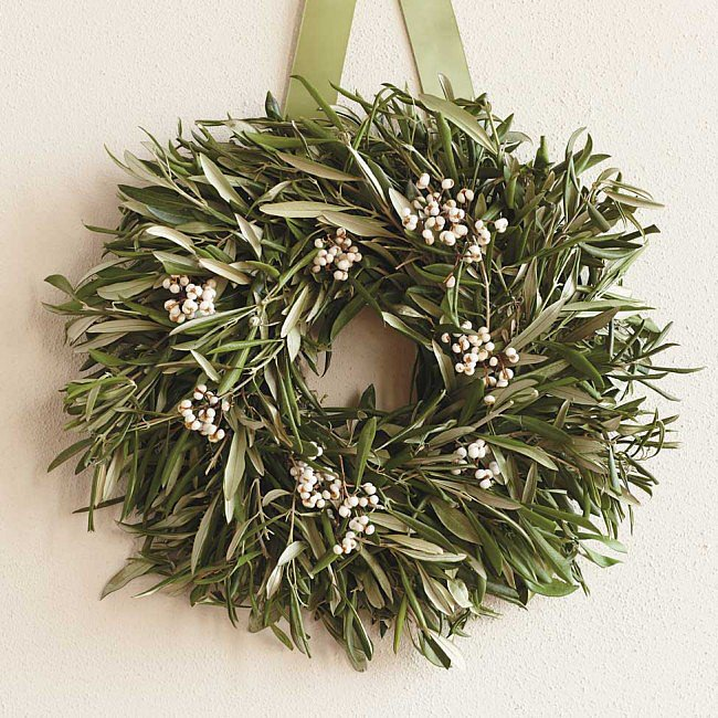 As seen displayed on the cupboard, this olive wreath ($69) would also make a great centerpiece laid flat on a table.