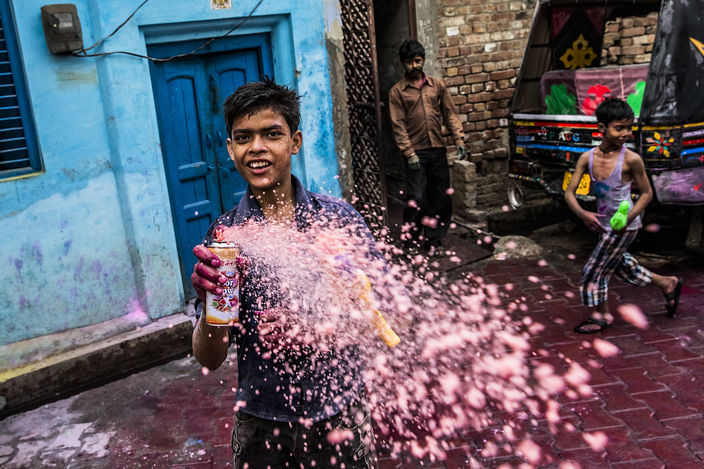 A boy sprays color during Holi celebrations in Vrindavan, India.