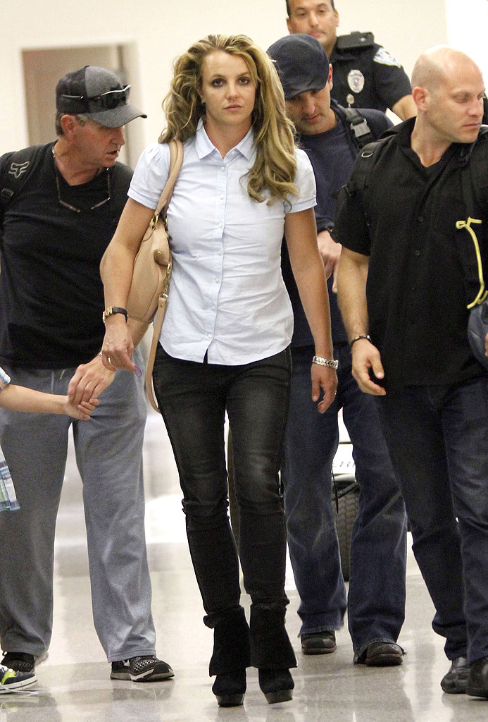Britney Spears walked through LAX with her family.