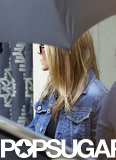 Jennifer Aniston wore a denim jacket.
