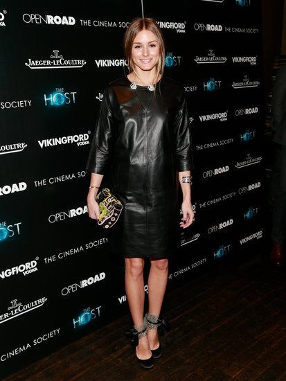 Olivia Palermo nailed the leather dress look, adding intrigue to her black Whistles shift with girlie Altuzarra heels and a printed Fendi clutch.