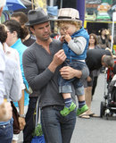 Justified star Walton Goggins carried his son during an Easter stroll through a farmers market in Studio City, CA.