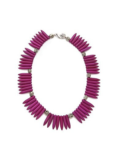 We love the dark fuchsia hue of this Made Her Think tooth and skulls necklace ($230).