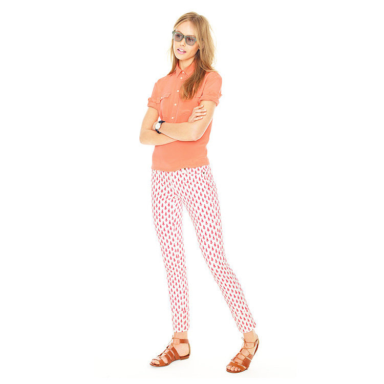 Take your coral hues to the next level by mixing printed pants with a silky top and '70s accessories.
