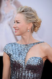 For a more structured bridal look, Naomi Watts provides a swept-up style that's incredibly chic.