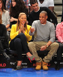 While sitting courtside at a New York Knicks game in February 2012, Beyoncé shined in a bright yellow Rag & Bone blazer and printed platform pumps, and Jay-Z kept it casual in a gray sweatshirt and khaki pants.