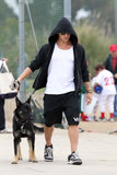 Ryan Phillippe adopted his German Shepherd from a shelter to cheer up his son, Deacon, and brought the pup along for one of Deacon's football games in LA in June 2011.