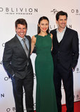 Tom Cruise, Olga Kurylenko, and Joseph Kosinski posed together at the premiere in Dublin.
