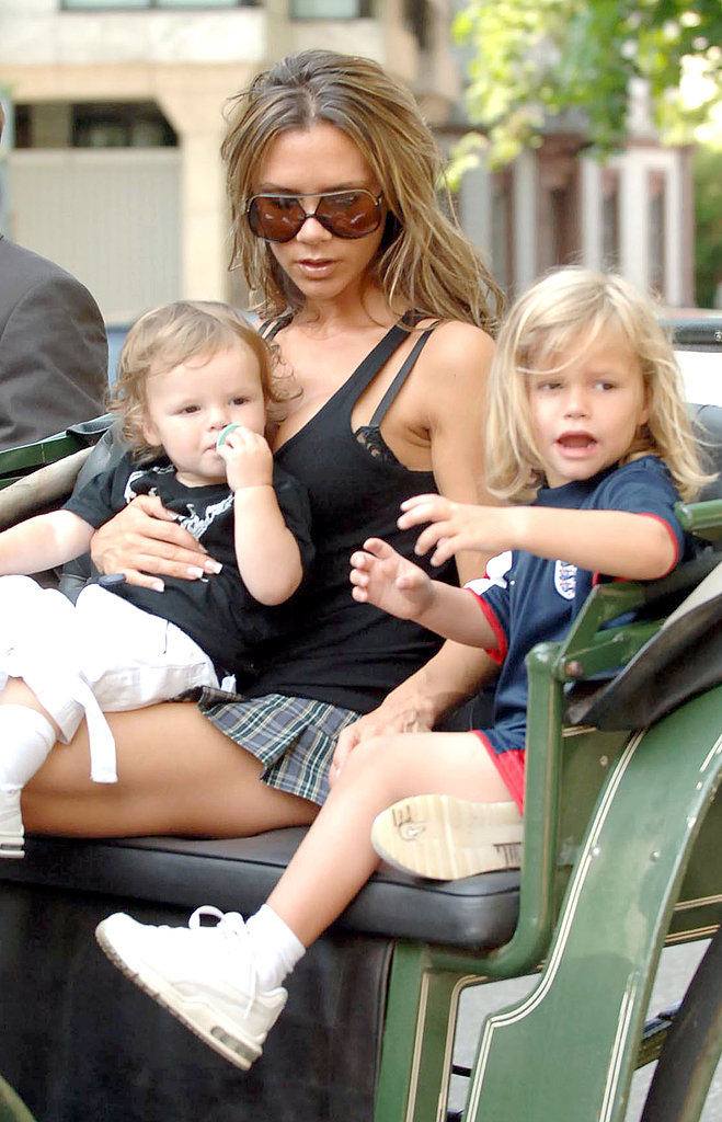 Victoria Beckham took baby Cruz and a long-haired Romeo on a sightseeing carriage ride through Baden, Germany, in June 2006.
