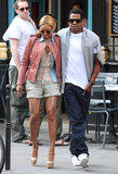 In April 2011, Beyoncé layered up in a chambray blouse and a pink leather Isabel Marant jacket, while Jay-Z threw a gray sweater over his crisp white tee for a stroll in Paris.