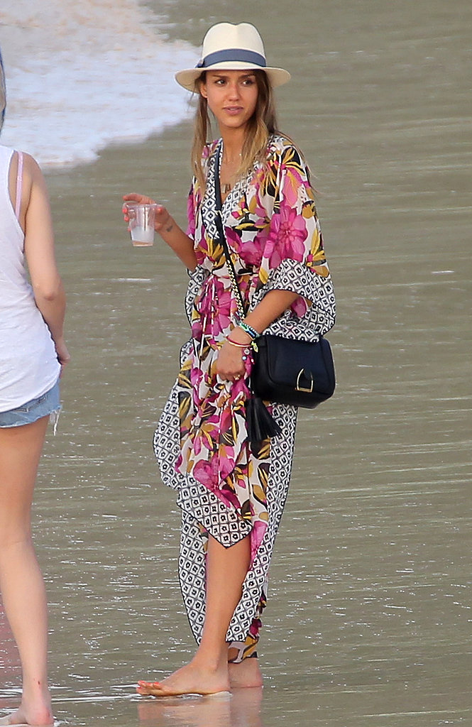 Jessica Alba brought her resort style to St. Barts when she matched a floral Tory Burch caftan with a cool Tory Burch fedora.