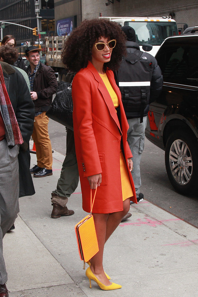 For an extra-bold look, experiment with Solange Knowles's sunny pairing. Find a yellow dress, pumps, and clutch, and add an unexpected touch via an orange jacket.