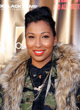 Singer Melanie Fiona went for a pompadour style, winged liner, and bright orange lips while attending the Free Angela and All Political Prisoners premiere in New York earlier this week.