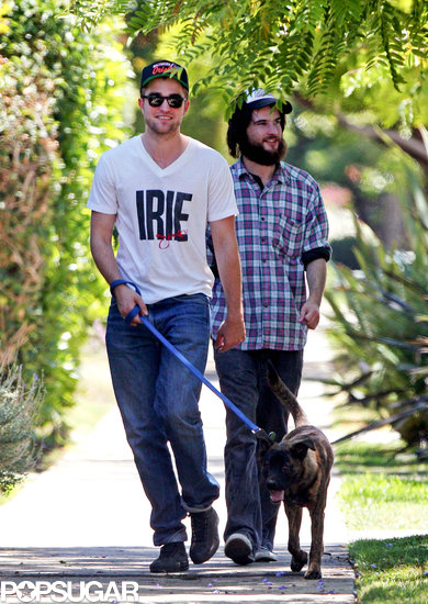 Robert Pattinson took Bear, a dog he adopted in New Orleans, for a guys' walk in LA in July 2011 with Tom Sturridge.