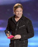 Brad Pitt looked happy when he presented the night's big award.