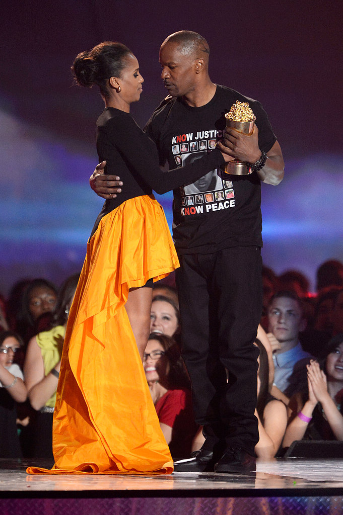 Django Unchained stars Kerry Washington and Jamie Foxx got close on stage when he won the night's Generation Award.