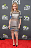 Kylie Minogue showed off her daring style in an armor-inspired silver-and-blue Paco Rabanne minidress with sheer panels. Classic black patent pumps completed her red-carpet look.