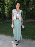 Possibly the coolest girl at the H&M Coachella party, decked out in an H&M denim vest, seafoam green maxi skirt, and some pretty awesome tattoos.  Source: Chi Diem Chau