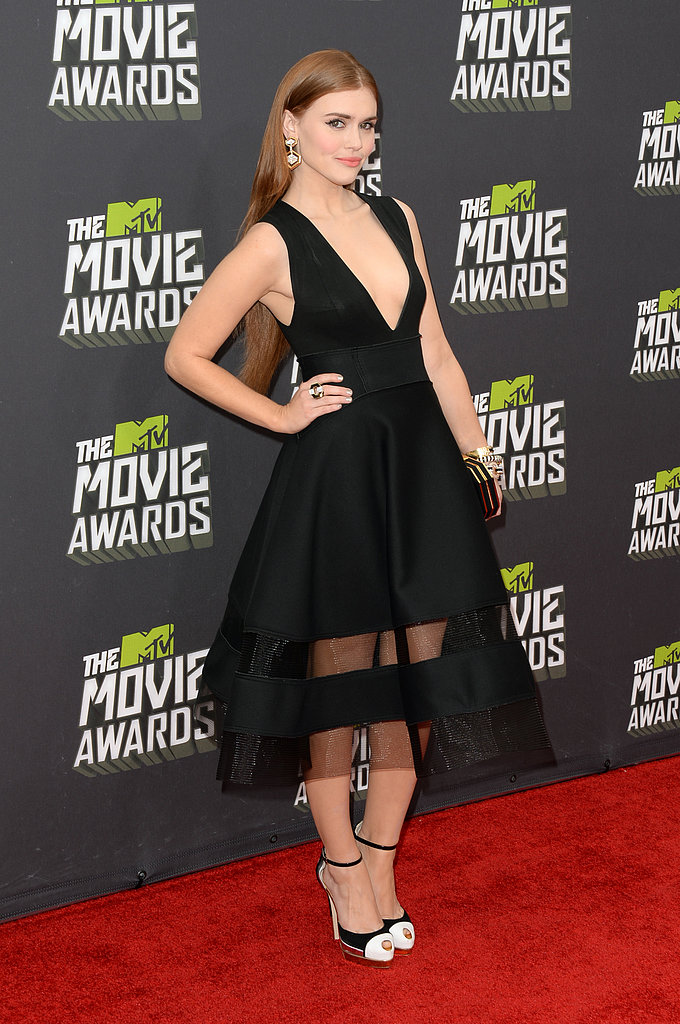 Holland Roden took the plunge in a daring black midi-length Donna Karan dress with a sheer skirt, then added unexpected white touches with cap-toe pumps and drop earrings.