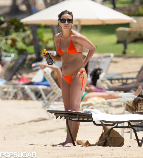 Eva Longoria wore an orange bikini in Puerto Rico.