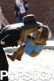Rachel Zoe kissed Skyler on a swing.