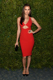 Irina Shayk showed off her model figure in a red body-con cutout dress by Michael Kors paired with black accessories.