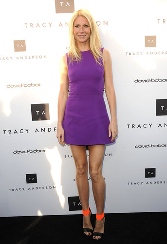 Gwyneth embraced color in a bright purple Victoria Beckham dress and ankle-strap Michael Kors sandals while celebrating the opening of Tracy Anderson's flagship studio in Brentwood, CA.