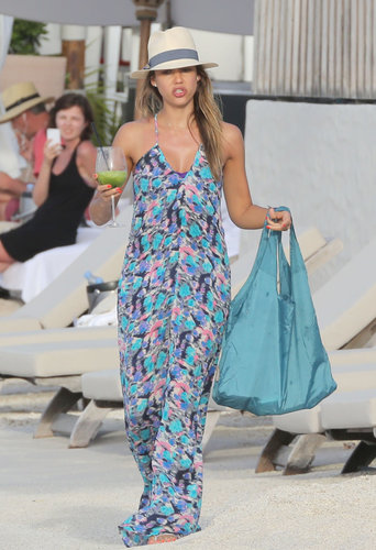 In St. Barts, Jessica Alba covered up her bikini with a printed maxi dress and a Tory Burch fedora.