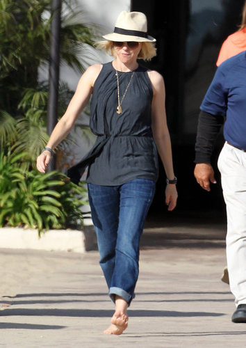 Naomi Watts strolled the beach in Santa Monica in April sporting a black sleeveless top, boyfriend jeans, and an off-white fedora.