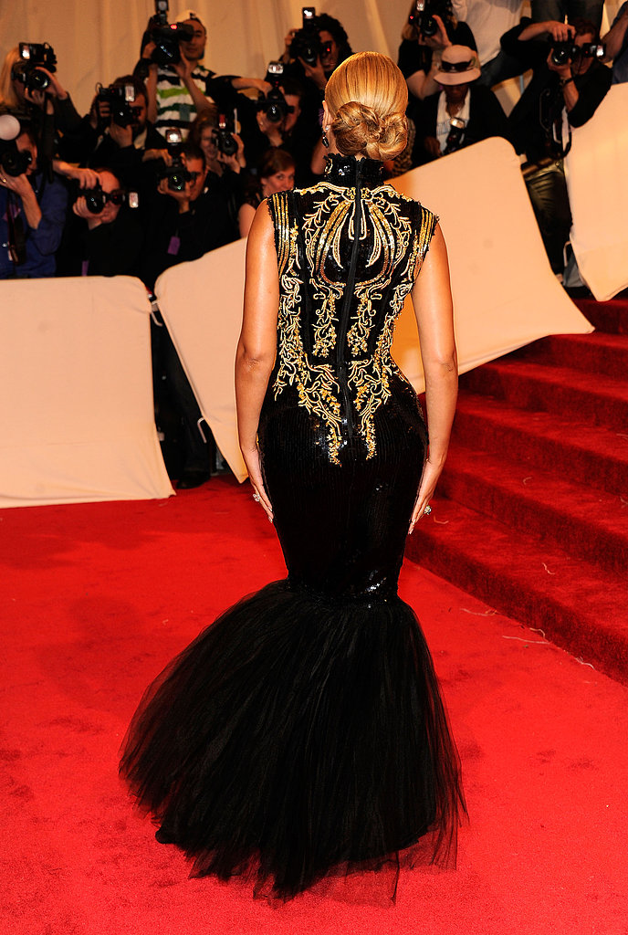 From the back, you can see just how formfitting her gold-and-black Emilio Pucci fishtail gown really was.