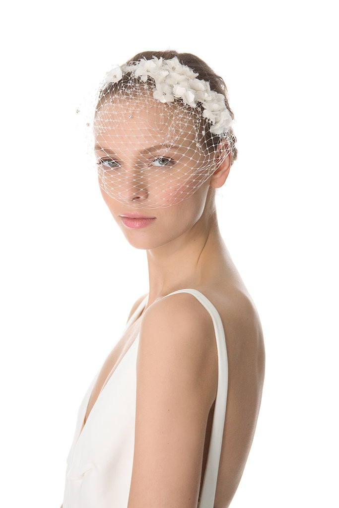 Jenny Packham's May veil ($648) features a barely-there mesh front and frayed silk floral detailing along the headband.