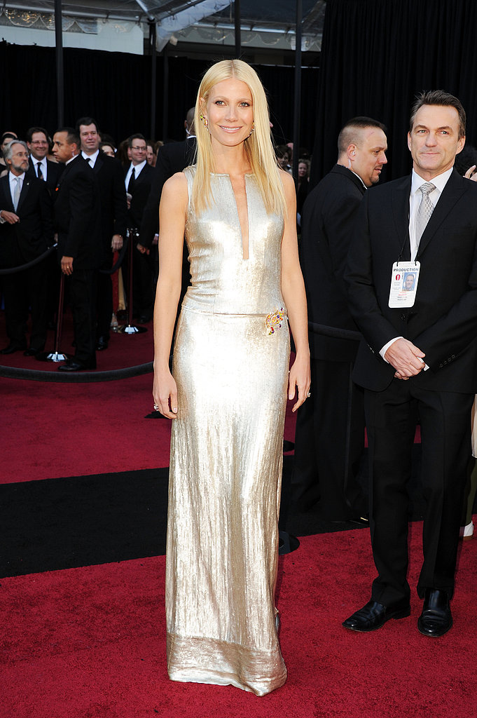 Gwyneth hit the red carpet in a sleek silver Calvin Klein gown and chunky Brian Atwood ankle-strap pumps at the 2011 Academy Awards in LA.