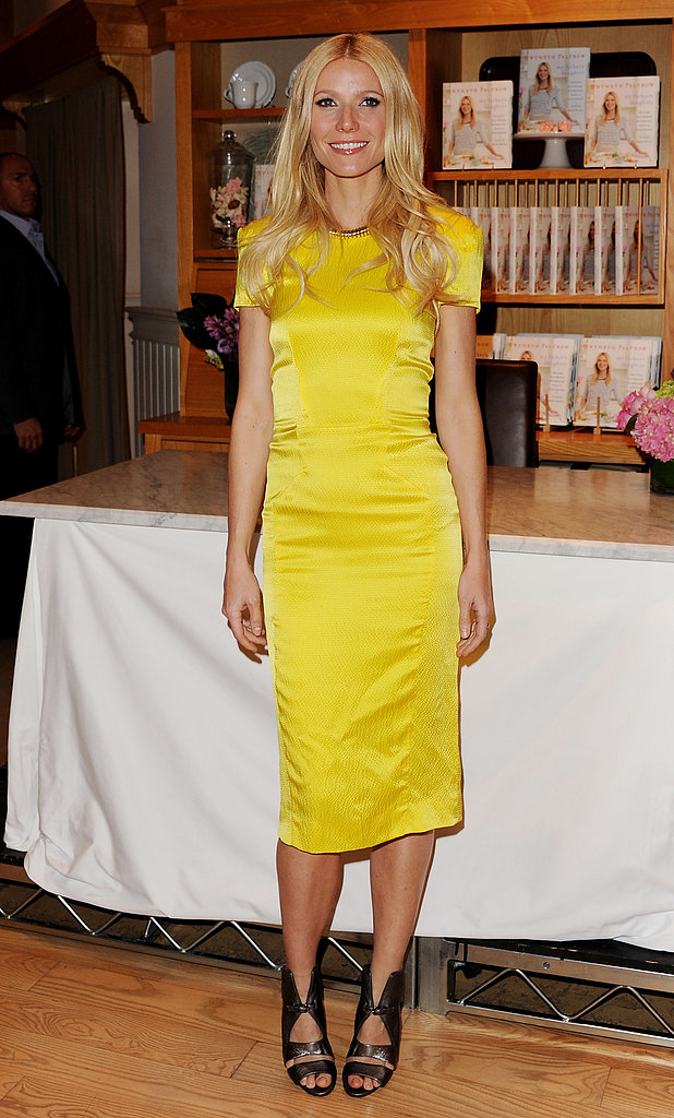 Gwyneth was a ray of sunshine in a satin Rachel Roy sheath and futuristic Camilla Skovgaard platinum sandals at a book signing in Beverly Hills.