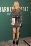 At a book signing in LA, Gwyneth took on the black and white trend in a printed Isabel Marant dress and cutout Michael Kors booties.