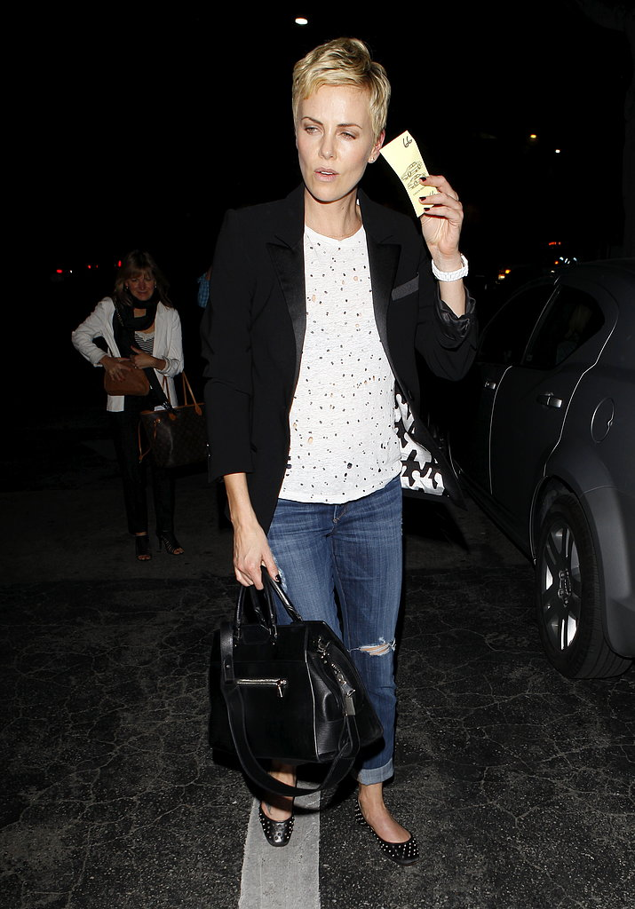 Charlize Theron wore jeans and a t-shirt.