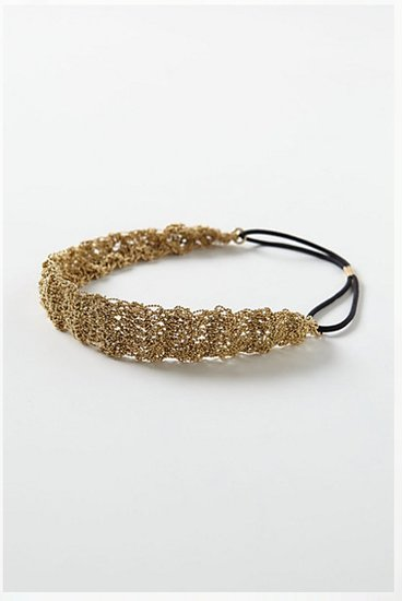 Anthropologie's metallic Tobiko headband ($38) would look gorgeous with a more casual wedding dress.