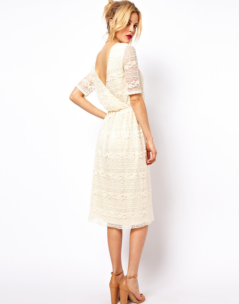 How gorgeous is this subtly sexy cream lace midi dress from ASOS ($50)? The longer length and three-quarter-length sleeves provide the demure angle, but the deep V-wrap from the back is undeniably sexy.