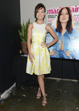 Olivia Wilde's yellow Monique Lhuillier fit-and-flare dress and metallic Jimmy Choo sandals would instantly brighten up any room.