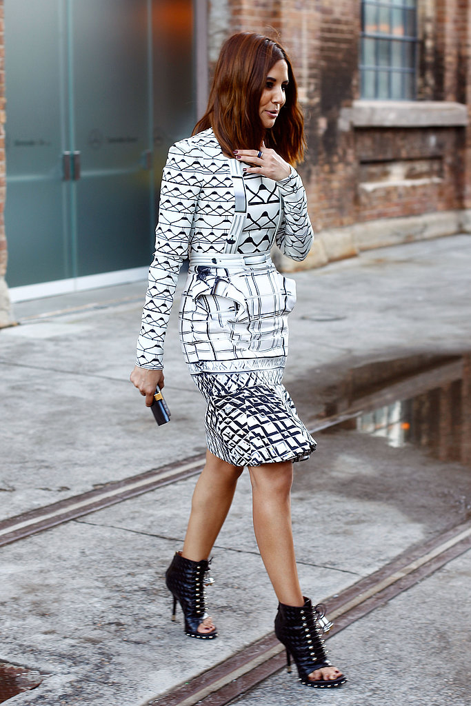 Vogue Australia editor Christine Centenera showed off her love for prints in a graphic fit and flare dress paired with sexy peep-toe booties.