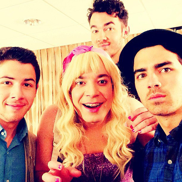 "Nick, Kevin, and Joe Jonas posed with their fan ""Sara"" (aka Jimmy Fallon). Source: Instagram user adamjosephj"