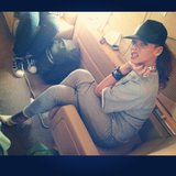 Rihanna posed on her private jet in a gray outfit and pointed-toe pumps. Source: Instagram user badgalriri