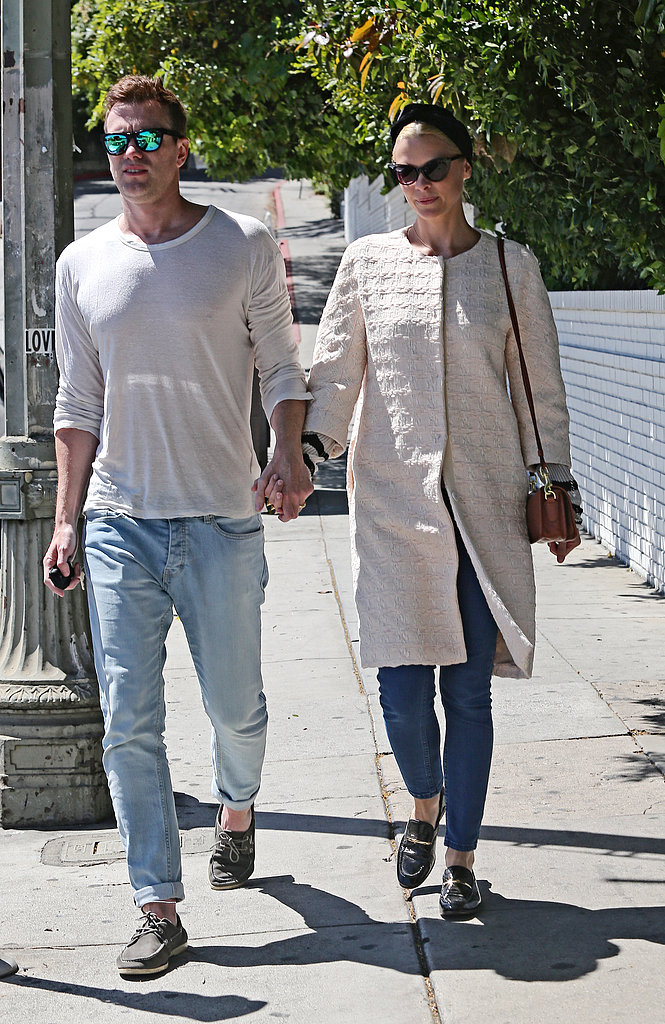 Jaime King took a sunny stroll in LA with her husband in cropped denim and black loafers with a Springy collarless coat, retro cat-eye sunglasses, and a turban-inspired headband.