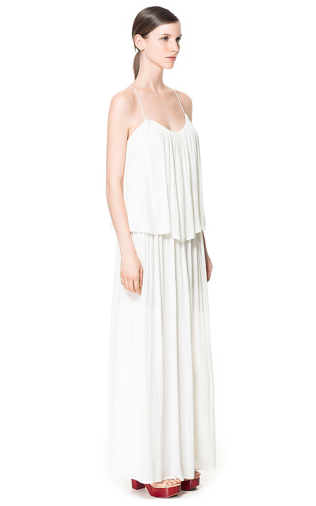 While on its own this strappy draped dress from Zara ($90) may seem a little casual, it has serious tropical wedding destination potential. Dress it up with a pair of statement earrings or a collar necklace, and then add a pair of metallic sandals.