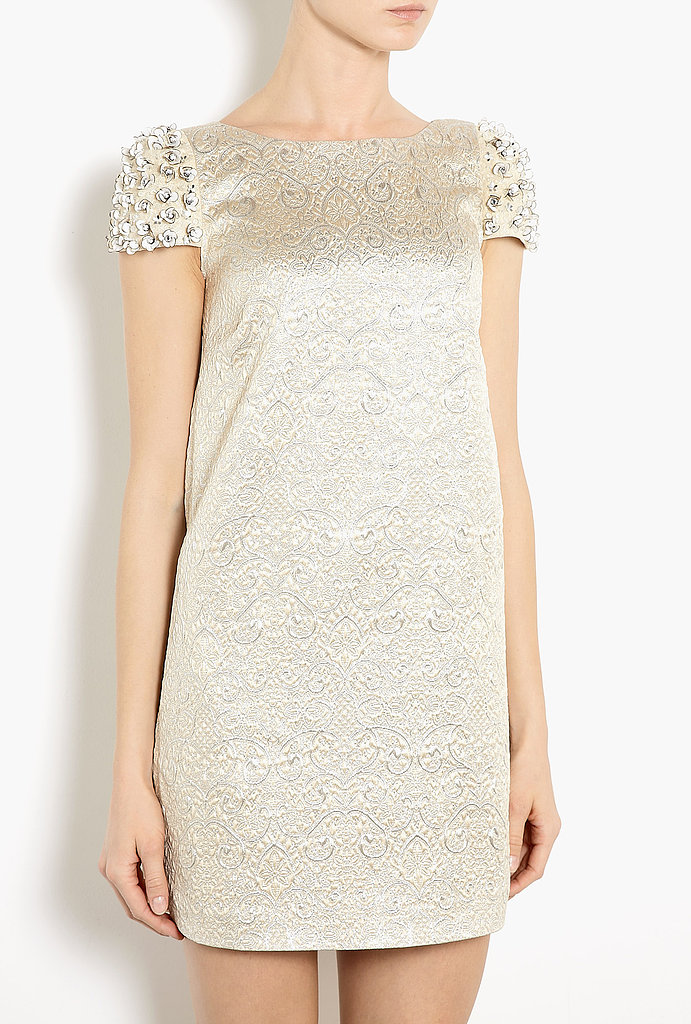 It's all about the details on this RED Valentino Gem-Embellished Brocade Dress ($726). Just look to the floral-adorned sleeves and glimmering silver threading along the brocade for proof.