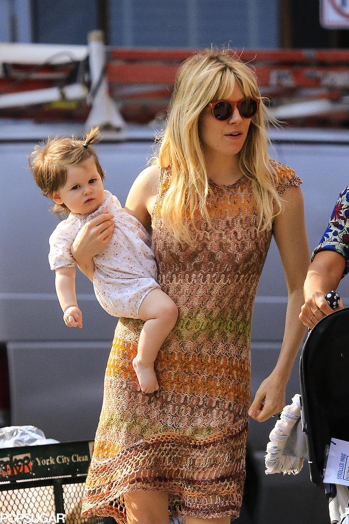 Sienna Miller cradled her daughter Marlowe Sturridge in NYC on Wednesday.