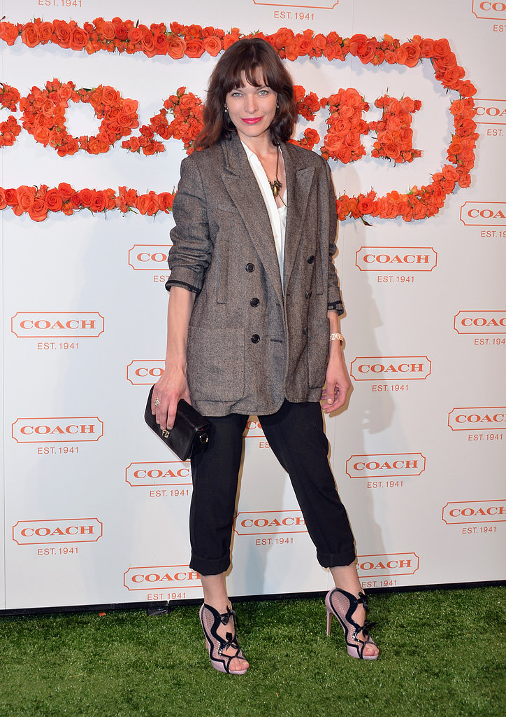 Milla Jovovich layered an oversize menswear jacket with cropped tapered pants and bow-tie sandals.