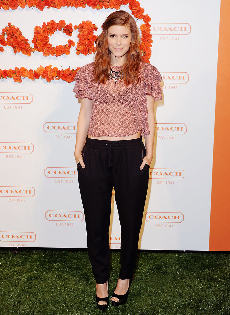 Kate Mara went with something ruffled and sheer on top, thanks to Vena Cava, then finished off her look with Tucker pants, a Dannijo necklace, and peep-toe Brian Atwood heels.
