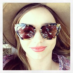 Miranda Kerr stayed shaded from the sun in tortoiseshell glasses and a straw hat while on a fishing trip with her family. Source: Instagram user mirandakerr
