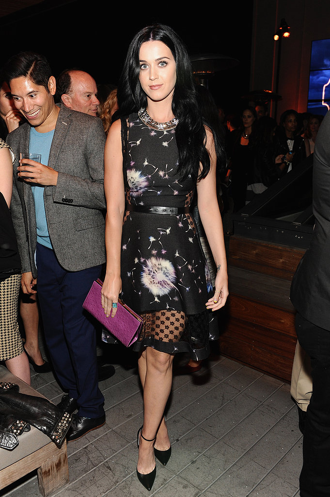 We are obsessed with Katy Perry's outfit choice at last night's Coach benefit. The singer chose a dandelion-print Thakoon dress from the designer's Fall '13 collection, then accessorized with Monika Chiang d'Orsay pumps and an orchid Coach Legacy ostrich-textured frame clutch.