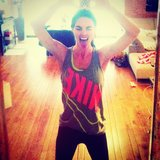 Hilary Rhoda just did it — her workout, that is — in a neon Nike tank. Source: Instagram user hilaryrhoda
